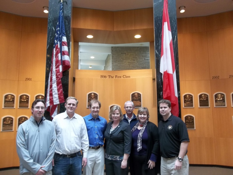 The seven Canadian Baseball Hall of Fame representatives at the National Baseball Hall of Fame on Friday. From left to right: Kevin Glew, Harry Gundy, Phil Parkinson, Lynn Hainer, Charlie Hammond, Tammy Adkin, Scott Crawford. (Courtesy of Scott Crawford)
