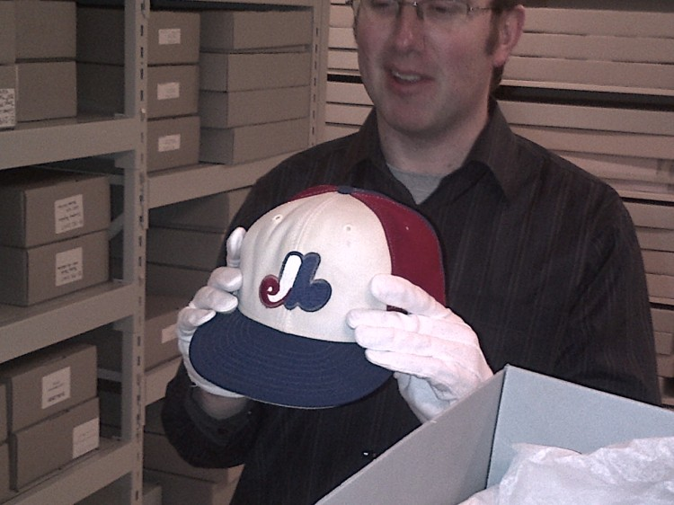 This is me in the 3D artifact room at the Hall of Fame holding Tim Wallach's hat from the 1984 season.