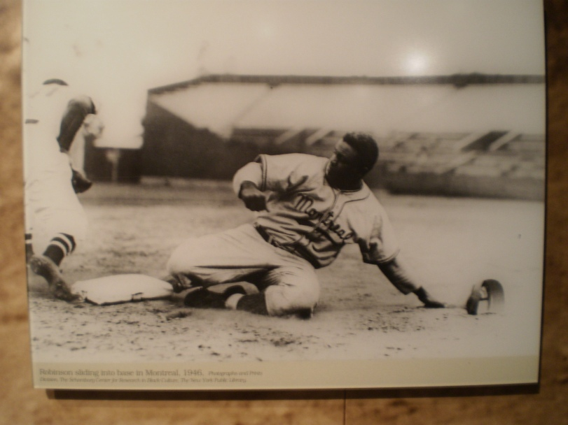 This is a photo of Jackie Robinson sliding into second base while he was with the Montreal Royals in 1946. This is on display in Robinson exhibit in the National Baseball Hall of Fame in Cooperstown.  Sorry for the pure quality I took a photo of the photo with my digital camera.