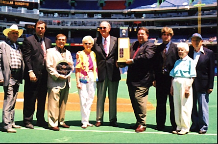 Tom Cheek (middle), surrounding by several Canadian Baseball Hall of Fame representatives, receiving the Hall's 2001 Jack Graney Award. (Photo: Courtesy of Canadian Baseball Hall of Fame)