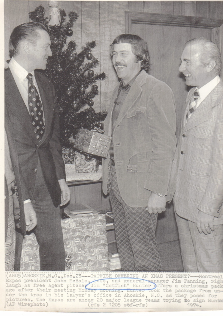 I recently purchased this photo off of eBay of Montreal Expos executives John McHale (left) and Jim Fanning (right) visiting free agent hurler Catfish Hunter (middle) in Ahoskie, N.C. on December 23, 1974.