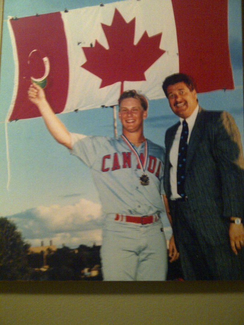 Oakville, Ont., native Todd Schell hit over .300 for the Canadian National Youth team that would gold in Brandon, Man., on August 4, 1991. Here he celebrates with Brandon, Manitoba mayor Rick Borotsik after the gold medal game. (Photo courtesy of Todd Schell).