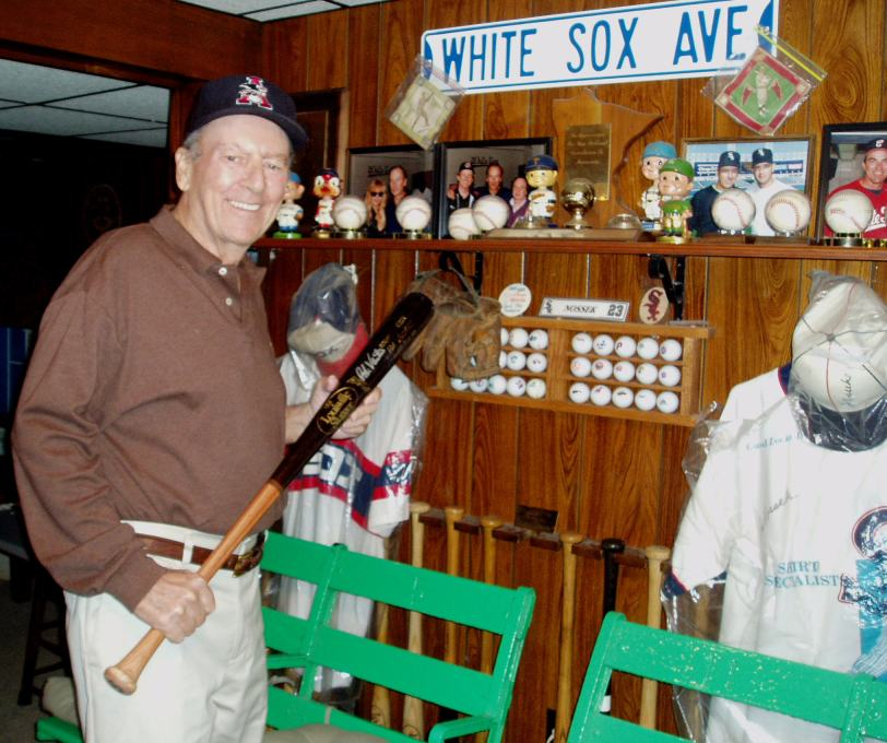 Joe Nossek stands in his home in Amherst, Ohio among some of the memorabilia he collected over the course of his career. (Photo courtesy of Joe Nossek)
