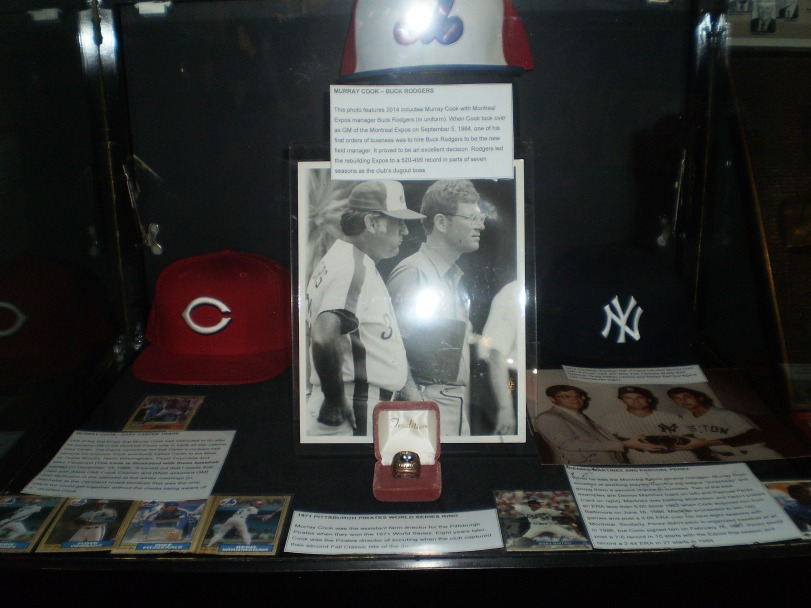 This is a photo of part of the Murray Cook display. The Sackville, N.B., native became the second Canadian to be a big league general manager (George Selkirk was the first) when he was named GM of the New York Yankees in June 1984. He would later serve as GM of the Montreal Expos and Cincinnati Reds. With this Expos, he hired Buck Rodgers to be their manager following the 1984 season. Cook also earned World Series rings serving in executive capacities with the Pittsburgh Pirates in 1971 and 1979. A 1971 World Series ring is part of his display.