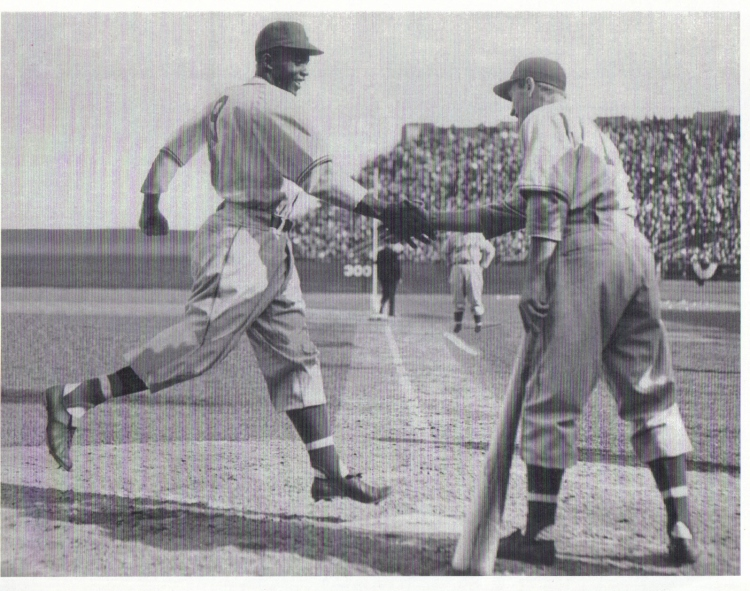 This is one of the famous photos of Montreal Royals outfielder George Shuba shaking Jackie Robinson's hand after Robinson's first homer in integrated baseball on April 18, 1946. (Courtesy: Canadian Baseball Hall of Fame)
